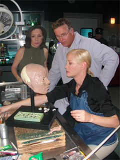 Forensic artist Karen T. Taylor on the set of CSI: with actors William Petersen and Pamela Gidley
