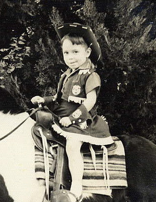 Karen T. Taylor as a young girl on a horse.